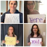 """Photo of Mental Health Staff holding signs saying """"We're Here for you"""""""